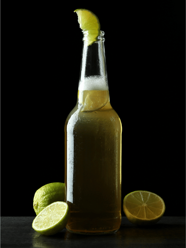 a beer garnished with limes cover photo